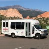 shuttle with Garden of the Gods and Pikes Peak in the background.