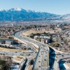 aerial view of austin bluffs parkway and pikes peak in the background