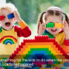 children playing with brightly colored building blocks