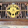 Stormwater drain with a gold USA basketball grate cover