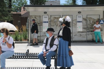 man and woman dressed in revolutionary era clothing