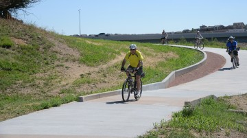 four bike riders on new concrete trail