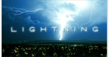 dark sky lit up by lightning