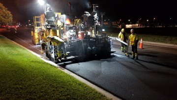 large asphalt roller paving new street
