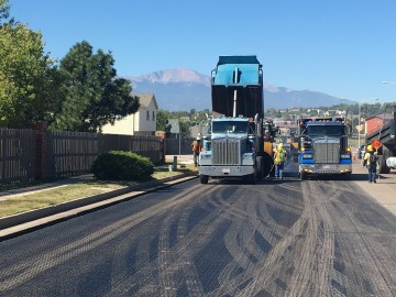 Dump truck and paving crews working on North Carefree Circle