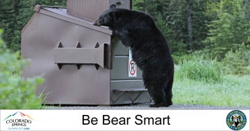 bear looking into dumpster. Be bear smart. City and Colorado Parks and Wildlife logos