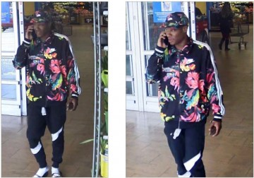 surveillance photos. both photos are of the suspect. Black man in a blue long sleeve shirt with large multi-color tropical flowers and white stripes down the sleeves. He is wearing a matching baseball hat. Blue athletic pants with a large white stripe