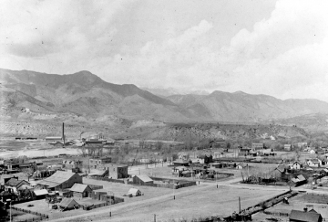 Black and White aerial photo of Old Colorado City with mountains in the background.