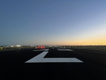 newly resurfaced runway with bright white striping