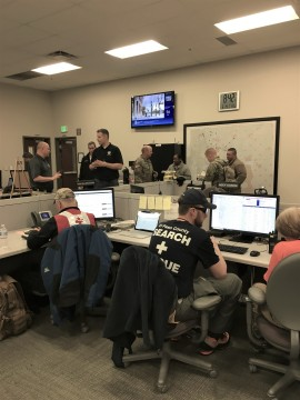 people representing multiple response agencies working in the coordination center