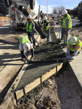 workers laying cement