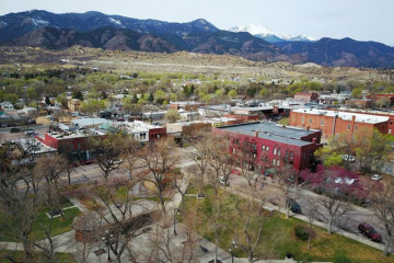 aerial view of Bancroft park and old colorado city with mountains in the background.