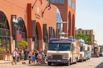 food trucks lining up along the street downtown