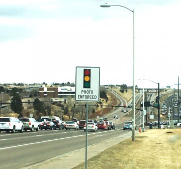 photo of red light camera warning sign