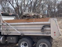 Dump truck full of trash and debris