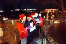 Holiday carolers singing