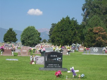 photo of gravestones and flowers at Evergreen Cemetery