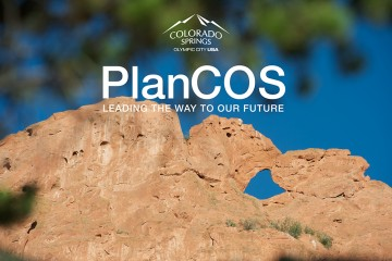 Kissing Camels at garden of the gods with PlanCOS logo