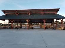 large picnic pavilion with large concrete area surrounding it