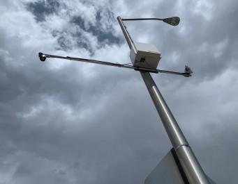 A weather sensor attached to a streetlight