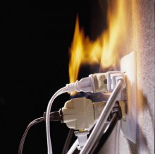 multiple plugs in an electrical outlet are on fire