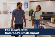 photo of couple at airport with the text: fall in love with colorado's small airport