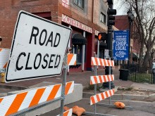 road closed sign and barriers blocking off street