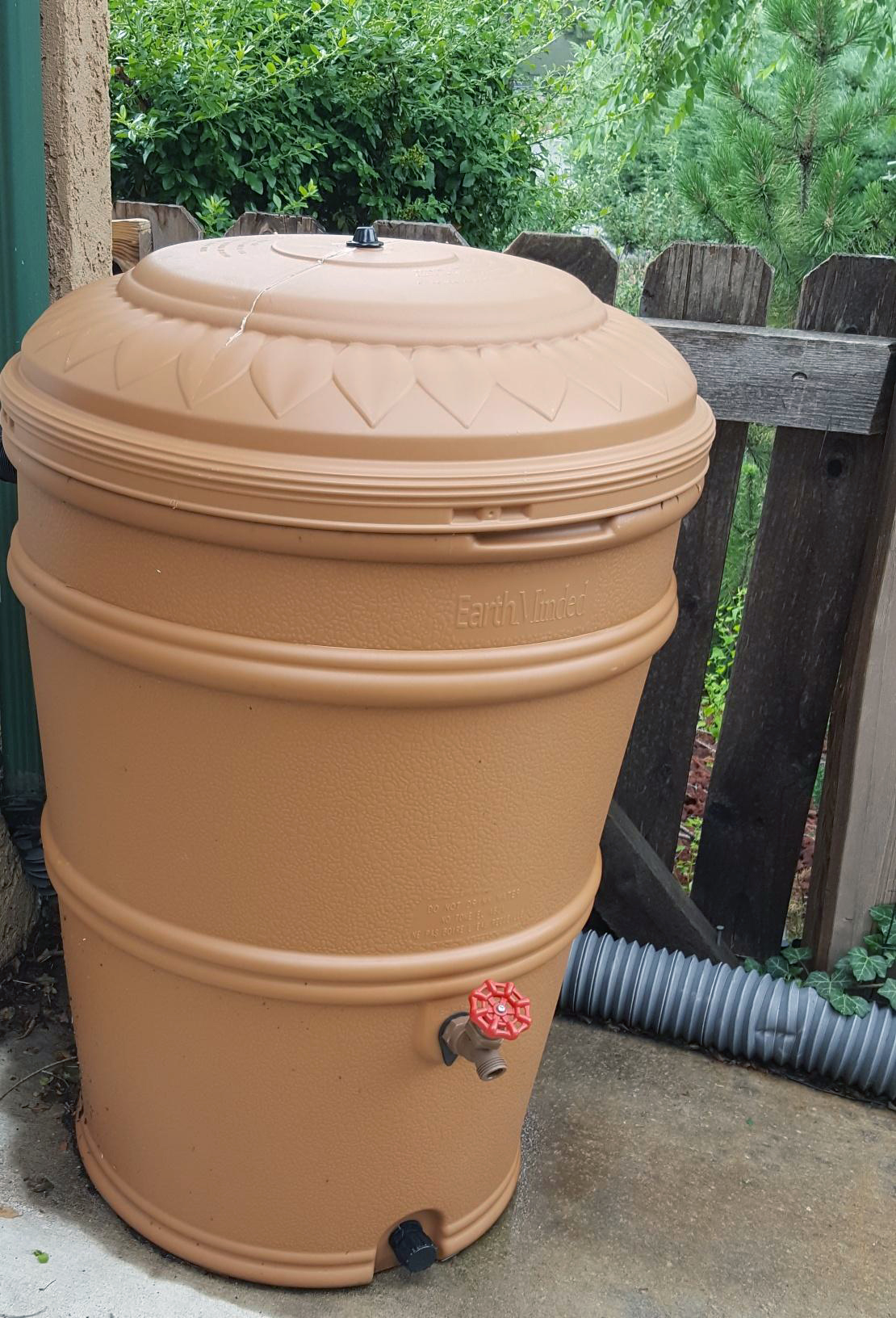 water catchment container with pour spout