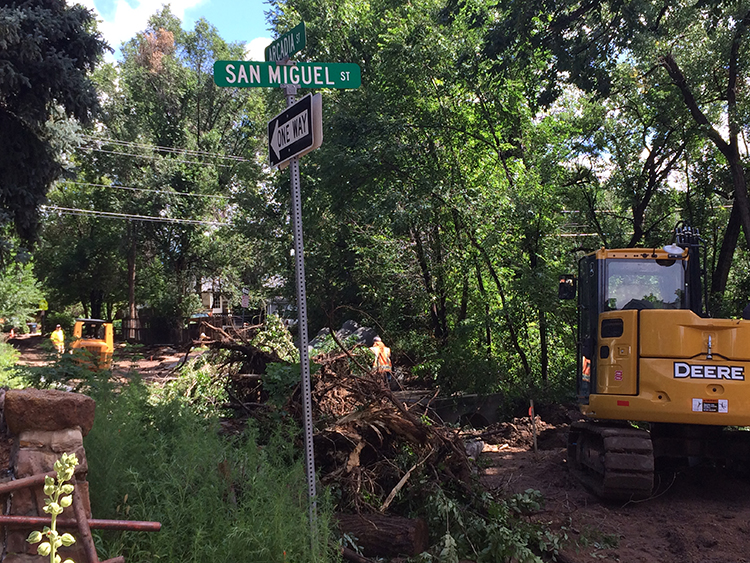 Arcadia street and San Miguel with tree debris and construction equipment